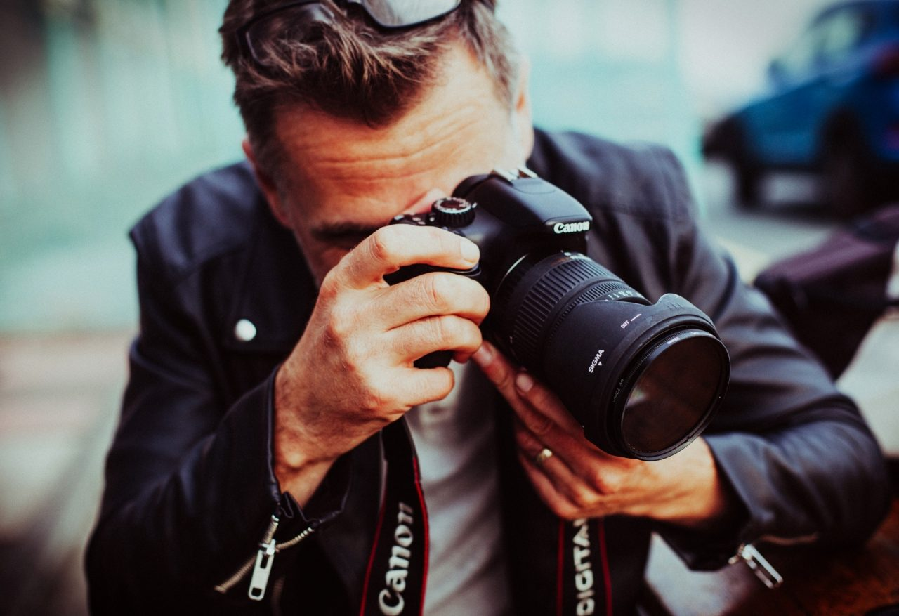 adult-middle-aged-man-photographer-with-canon-camera-327-small-8872828