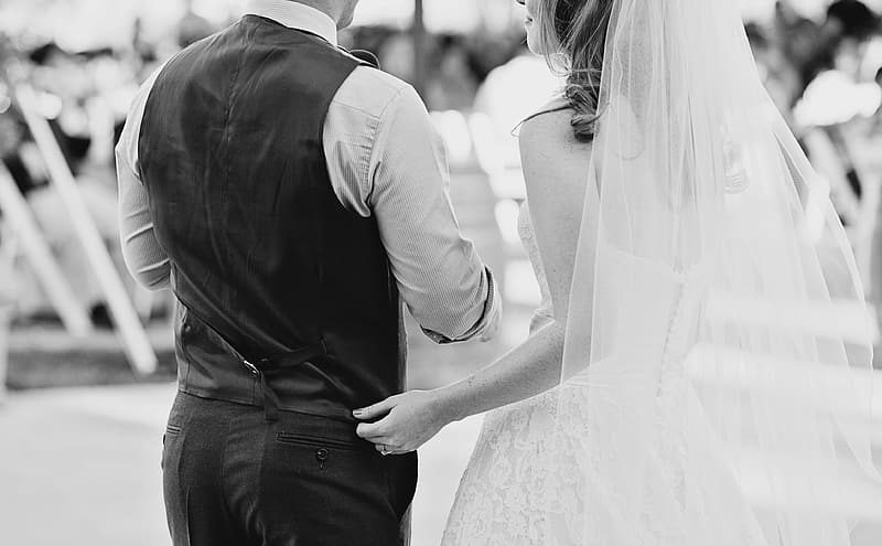grayscale-photography-of-couple-in-wedding-dress-and-suit-6052659